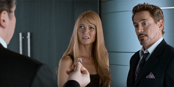 Pepper Potts looking exasperated at Tony Stark and Happy Hogan