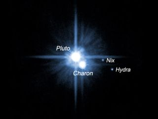 A pair of small moons orbiting Pluto named Nix and Hydra were discovered by NASA's Hubble Space Telescope in 2005. The two moons are roughly 5,000 times fainter than Pluto and are about two to three times farther from Pluto than its large moon, Charon, wh