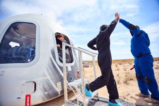 Blue Origin employees practice exiting a New Shepard capsule after an uncrewed test flight.
