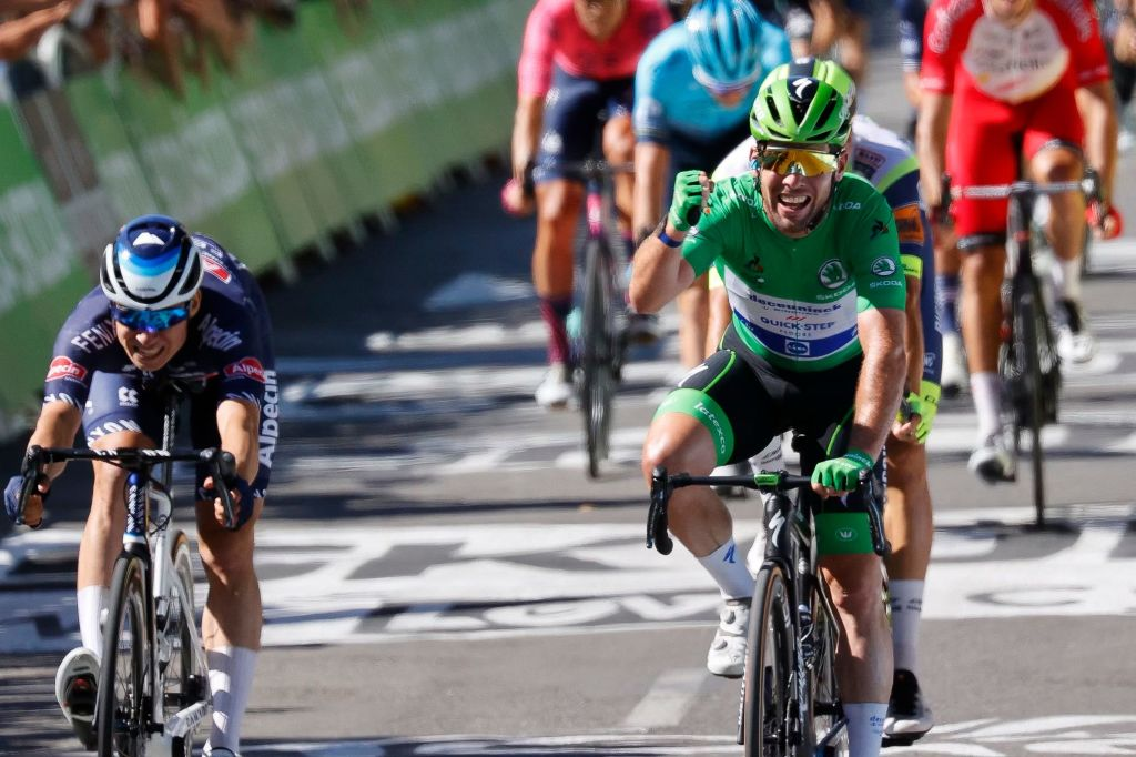 Stage winner Team Deceuninck Quicksteps Mark Cavendish of Great Britain wearing the best sprinters green jersey crosses the finish line at the end of the 13th stage of the 108th edition of the Tour de France cycling race 219 km between Nimes and Carcassonne on July 9 2021 Photo by Thomas SAMSON AFP Photo by THOMAS SAMSONAFP via Getty Images