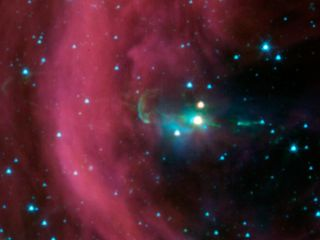 NASA's Spitzer Space Telescope took this image of a baby star sprouting two identical jets (green lines emanating from fuzzy star). The Spitzer image shows that both of the twin jets are made up of identical knots of gas and dust, ejected one after anothe