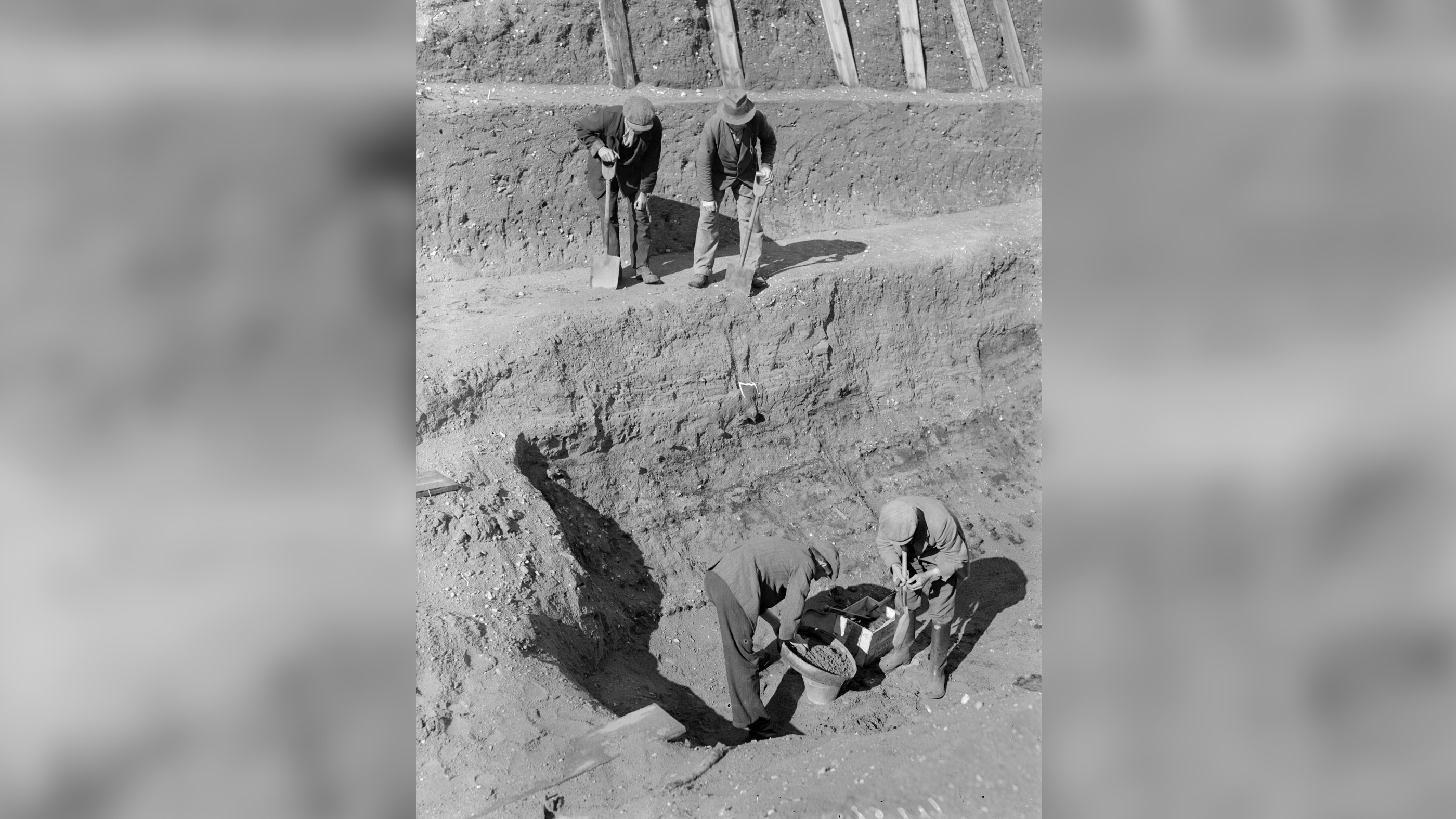 On July 31, 1939, workmen sift through earth at the bottom of the excavation of the Anglo-Saxon burial ship at Sutton Hoo in Suffolk, England.