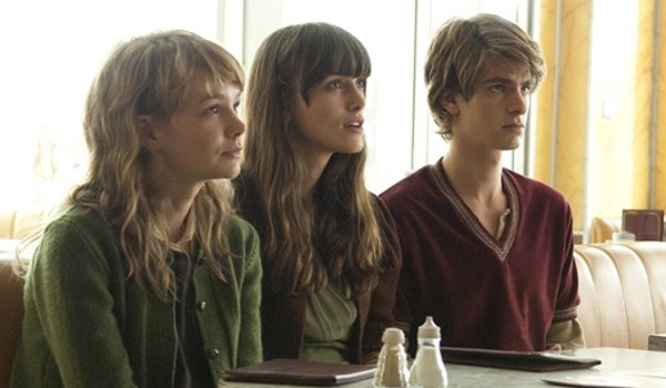 Never Let Me Go Carey Mulligan Keira Knightley Andrew Garfield sitting at a table, looking up expect