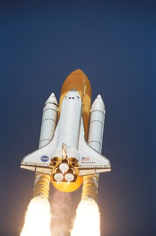Space Shuttle Discovery launches on July 26, 2005.