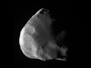 NASA's Cassini spacecraft snapped this photo of Saturn's icy moon Helene on June 18, 2011. At closest approach, Cassini flew within 4,330 miles (6,968 kilometers) of Helene's surface.