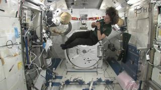 Irish astronaut Cady Coleman plays a pennywhistle on loan from the Irish band The Chieftains while flying in the Japanese Kibo lab on the International Space Station on St. Patrick's Day, March 17, 2011.