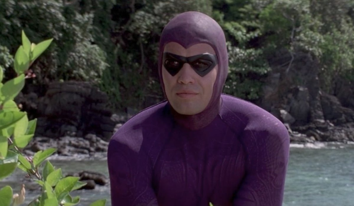 Billy Zane stands costumed, in the bright jungle, in The Phantom.