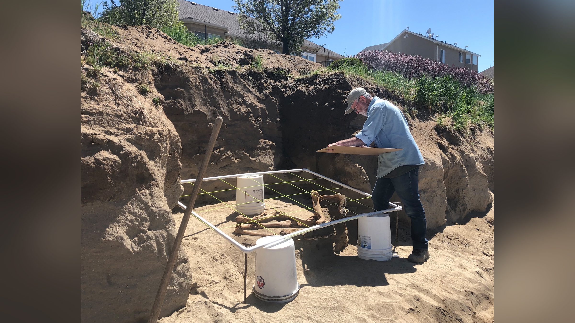 Paleontologist Rick Hunter excavates the Lehi horse skeleton from a backyard in Utah.