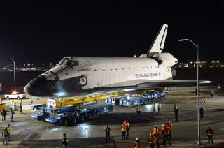 Space shuttle Endeavour is seen on top the overland transporter beginning its two-day, 12-mile L.A. road trip.