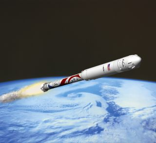 An artist's illustration of ATK's new Liberty rocket launching a private space capsule into low-Earth orbit.