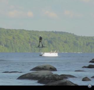 Screenshot of man on hoverboard.