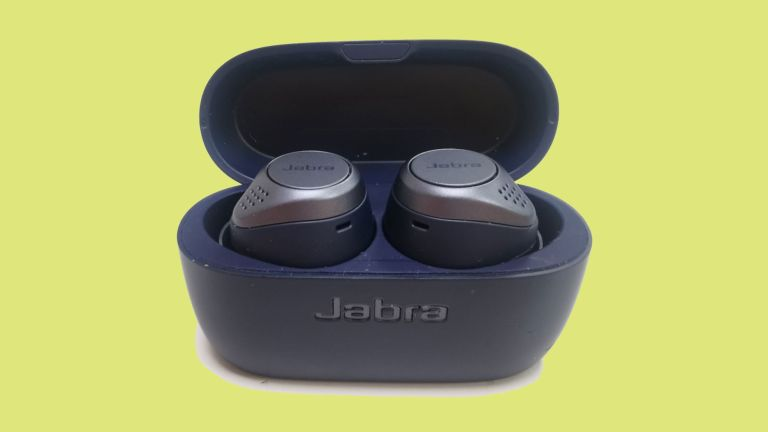 Jabra Elite Active 75t review: the earbuds in their charging case against a green background