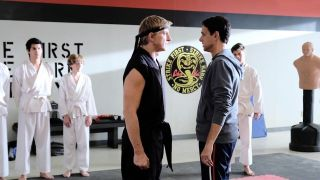 Daniel LaRusso (Ralph Macchio) and Johnny Lawrence (William Zabka) face off in the Cobra Kai dojo.