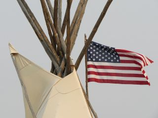 American flag next to teepee