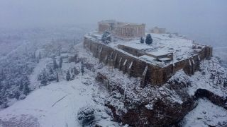 The ancient Acropolis in Athens was covered in white during a rare snowfall on Feb. 16, 2021.