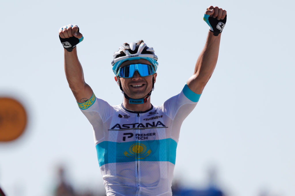 Stage winner Team Astana rider Kazakhstans Alexey Lutsenko celebrates as he crosses the finish line of the 6th stage of the 107th edition of the Tour de France cycling race 191 km between Le Teil and Mont Aigoual on September 3 2020 Photo by Christophe Ena POOL AFP Photo by CHRISTOPHE ENAPOOLAFP via Getty Images