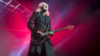Brian May of Queen performs live on stage at The O2 Arena on December 12, 2017 in London, England