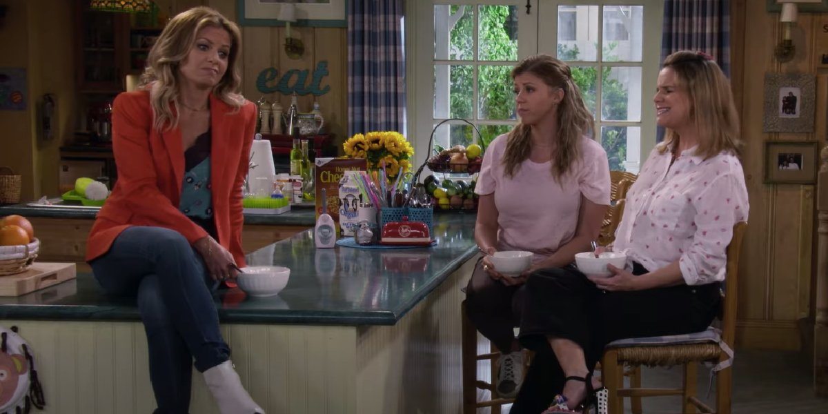 Fuller House DJ, Stephanie, and Kimmy eating ice cream in the kitchen