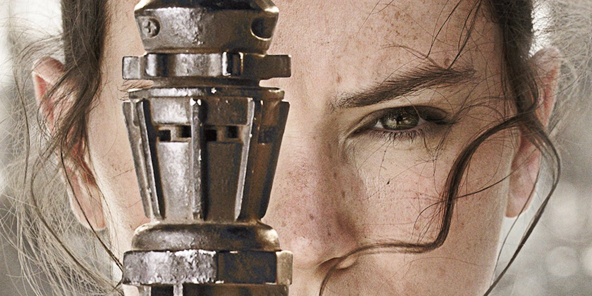 Rey wielding her staff in a poster for Star Wars: The Force Awakens