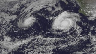 NOAA's GOES East satellite captured this visible image of Hurricanes Irwin (left) and Hilary (right) spinning in the east Pacific Ocean on July 25, 2017.