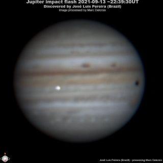 Brazilian observer José Luis Pereira captured this shot of an impactor (bright flash at center-left) hitting Jupiter on Sept. 13, 2021.