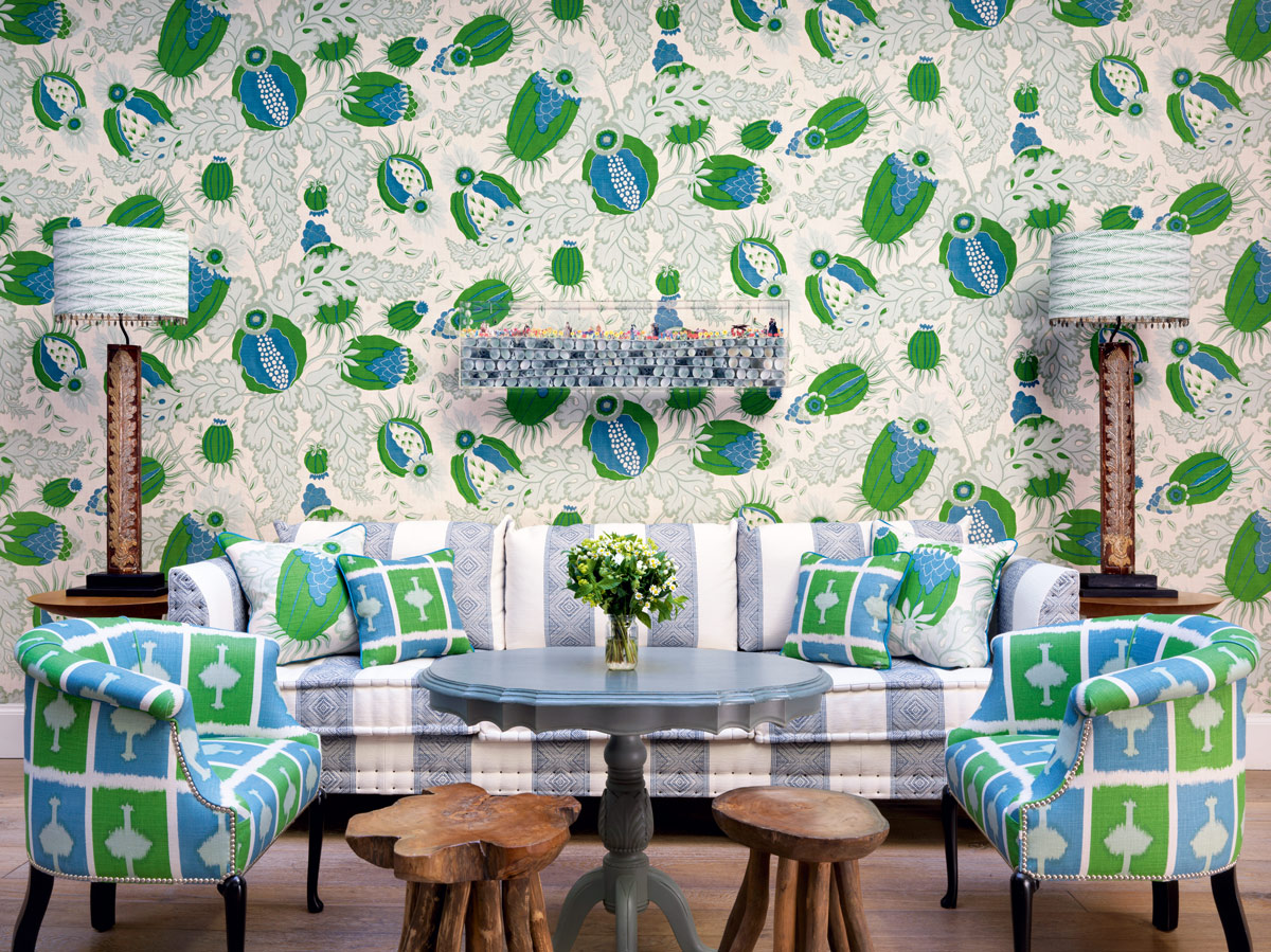Carnival wallpaper by Michael Szell £85m setting a busy backdrop for chairs and cushions upholstered in Ozone £150m both by Christopher Farr Cloth. & 8 Modern Living Room Ideas | Livingetc