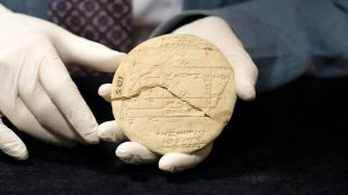 The tablet was used by a surveyor to accurately divide up land.