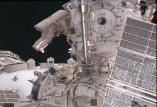Russian cosmonauts Dmitry Kondratyev and Oleg Skripochka completed a spacewalk to upgrade the International Space Station on Jan. 21, 2011.