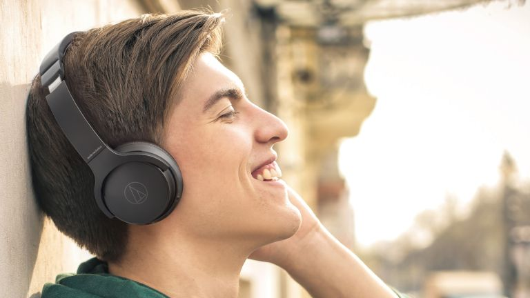 Audio-Technica ATH-S220BT in black worn by man outside