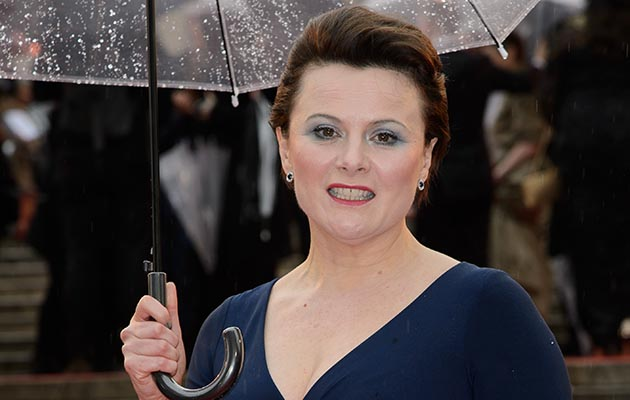 Monica Dolan, who is appearing in A Very English Scandal, shields herself under an umbrella
