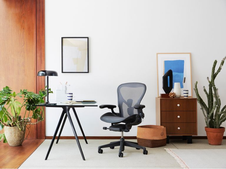 best office chairs: modern office with wheeled chair