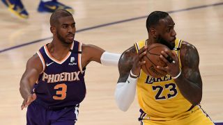 LeBron James #23 of the Los Angeles Lakers is fouled by Chris Paul #3 of the Phoenix Suns as he spins in the second quarter during game six of the Western Conference first round series at Staples Center on June 3, 2021 in Los Angeles, California.