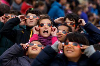 Children watching eclipse in Spain