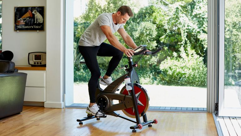 Man figuring out how to use an exercise bike