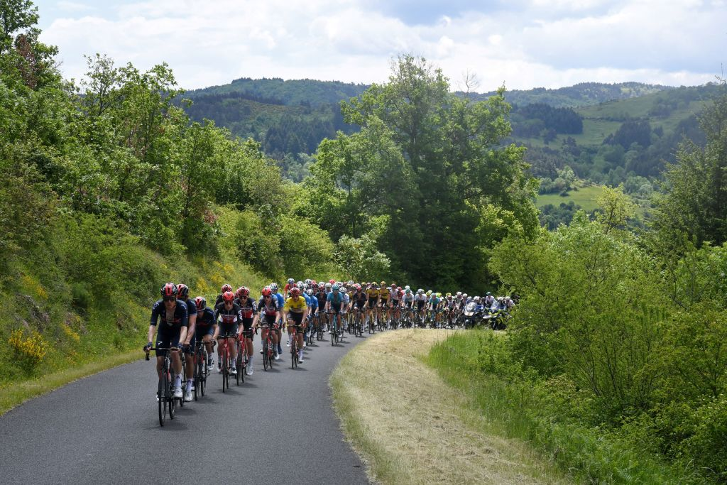 The pack rides during the second stage of the 73rd edition of the Criterium du Dauphine cycling race 173km between Brioude and Saugues on May 31 2021 Photo by Alain JOCARD AFP Photo by ALAIN JOCARDAFP via Getty Images