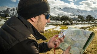 how to take a bearing – man with map and compass