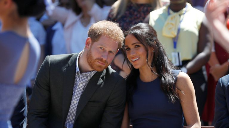 Prince Harry, Duke of Sussex and Meghan, Duchess of Sussex watch a performance during their visit to Macarthur Girls High School on October 19, 2018 in Sydney, Australia. The Duke and Duchess of Sussex are on their official 16-day Autumn tour visiting cities in Australia, Fiji, Tonga and New Zealand.