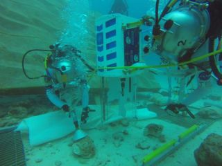 Two aquanauts at work on the seafloor as part of NEEMO 18