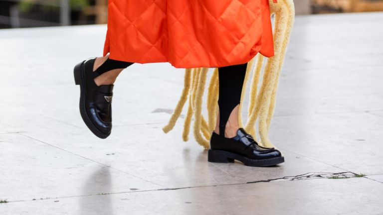 Loafers - woman wearing Prada Loafers at fashion week
