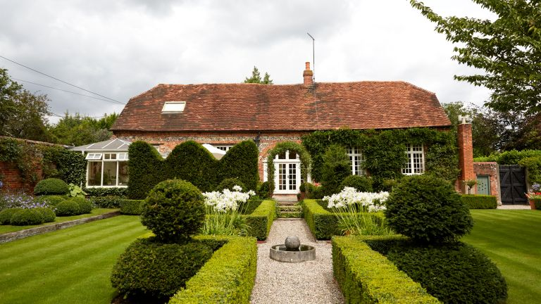 Cut hedges outside a country house