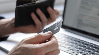 Person buying products online using a credit card