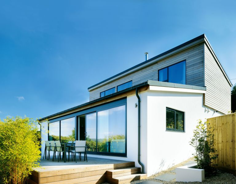 Improve your home without planning permission. Pocket sliding doors in contemporary extension photographed by nigel rigden