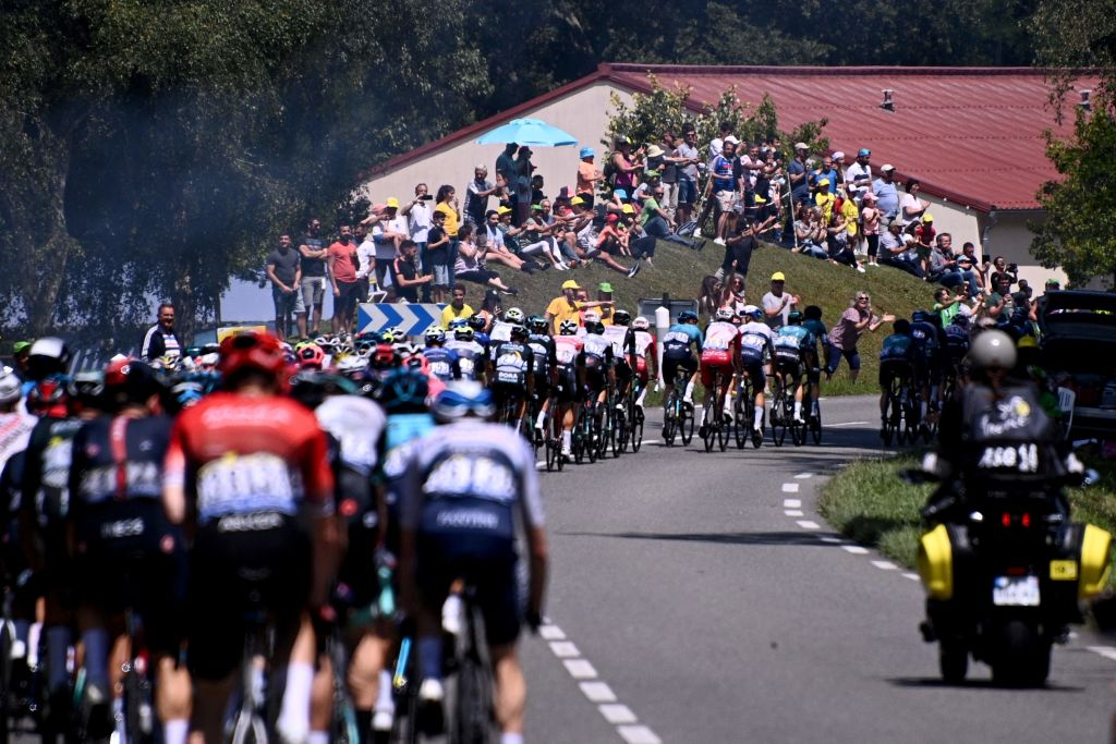 The pack rides during the 19th stage of the 108th edition of the Tour de France cycling race 207 km between Mourenx and Libourne on July 16 2021 Photo by AnneChristine POUJOULAT AFP Photo by ANNECHRISTINE POUJOULATAFP via Getty Images