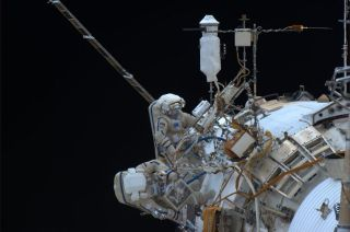 Cosmonauts Oleg Kotov, Expedition 38 commander, and flight engineer Sergey Ryazanskiy perform a spacewalk outside the International Space Station on Dec. 27, 2013. NASA astronaut Rick Mastracchio took this photo from inside the station.