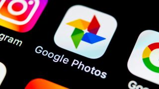 Angled shot of the Google Photos app logo on a screen