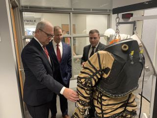 "NASA Administrator Jim Bridenstine (center) reviews the NDX-1 pressurized spacesuit, made at the University of North Dakota, along with spacesuit principal investigator and UND professor Pablo de Leon (right). At left is North Dakota senator Kevin Cramer. In a tweet accompanying this picture taken on Sept. 4, 2019, Bridenstine said of the NASA-funded spacesuits, ""The work being done here will benefit our #Artemis program to send humans to the Moon and our eventual missions to Mars and beyond."""
