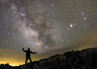 Skywatcher Holds Up the Night Sky Over the Azores