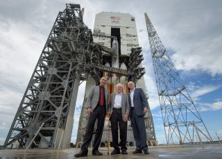 NASA Science Mission Directorate Associate Administrator Thomas Zurbuchen (left), solar astrophysicist Eugene Parker (center) and United Launch Alliance President Tory Bruno stand in front of NASA's Parker Solar Probe and its Delta IV Heavy rocket before the mission's Aug. 12, 2018 launch.
