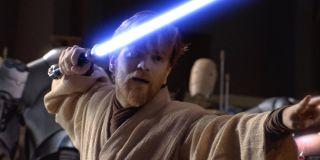 Ewan McGregor as Obi-wan Kenobi with a lightsaber