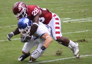 A football player tackles another player during a game.